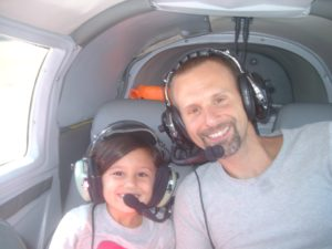 Pilot Charles George flying passenger Chris N. and his daughter Christina.